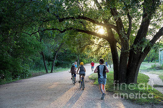 Herronstock Prints - A late afternoon sunset greets runners and bikers on the Lady Bird Lake Hike and Bike Trail in downtown Austin
