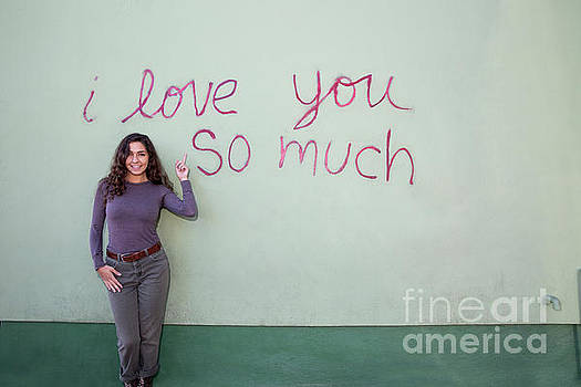 Herronstock Prints - A local Austin woman poses in front of the iconic I Love You So Much mural on South Congress Avenue