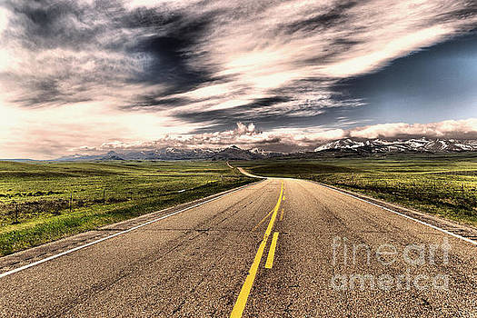 A long road to the mountains by Jeff Swan