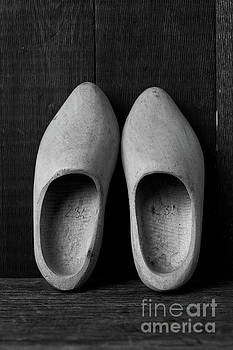 A pair of old wooden shoes by Edward Fielding