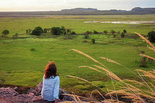 A person admiring the view from Ubirr Rock, Australia by Daniela Constantinescu