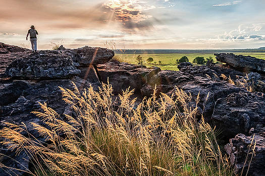 A person exploring Ubirr Rock, NT, Australia by Daniela Constantinescu