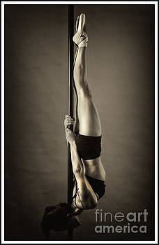 A pole fitness dancer inverted by Michael Edwards