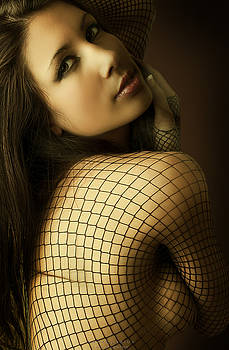 A portrait of an spanish woman into a net a second before she smiles by AndyQuarius