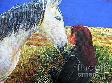 A pretty girl with her desert Horse by Jodie  Scheller