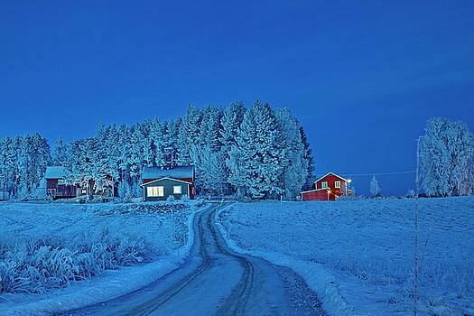 A road leads towards a frost covered village by Ulrich Kunst And Bettina Scheidulin
