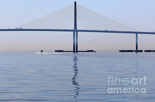 A sailboat and a motor yacht pass the Bob Graham Sunshine Skyway by Louise Heusinkveld
