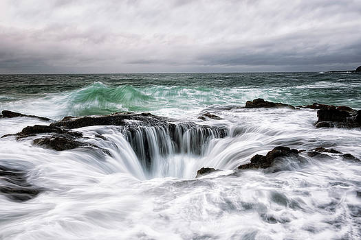 A stormy high tide replenishes the undersea grotto known as Thor's Well. by Larry Geddis