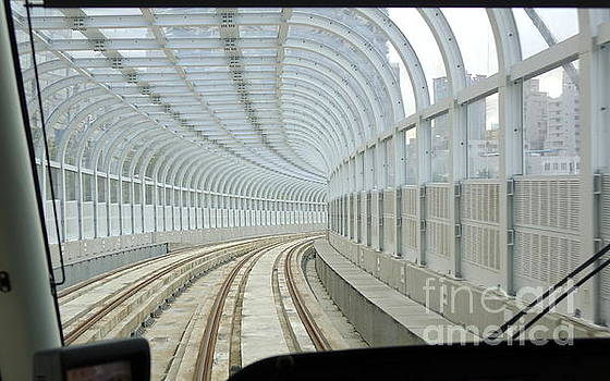 A streetcar moves drives on a covered track by Yali Shi