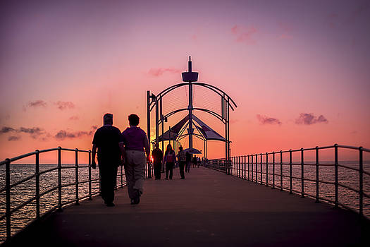 A Stroll Along Sunset Pier by Ray Warren
