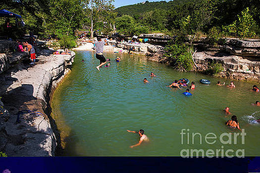 Herronstock Prints - A swimmer leaps off the cliff at Bull Creek District Park, known as Austins best swimming hole