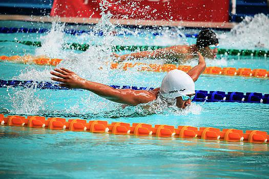 A swimmer making a butterfly stroke by Jim De Ramos