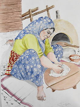 A Woman Making Bread by Engin Yuksel