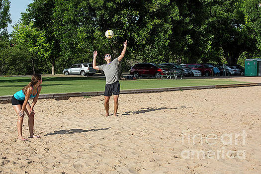 Herronstock Prints - A young male athlete serving and playing volleyball on Zilker Park sand volleyball courts