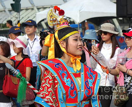 A young woman dressed in a festive native costume by Yali Shi