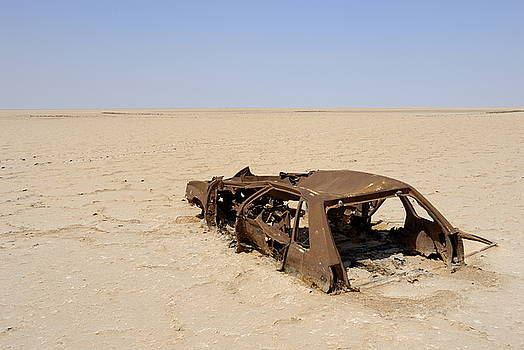 Sami Sarkis - Abandoned and rusty car wreck in desert