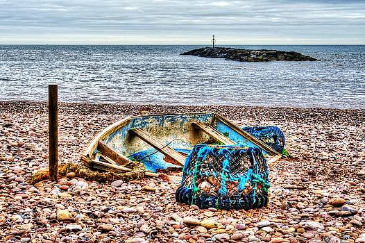 Abandoned boat and Lobster Pot  by Chris Day