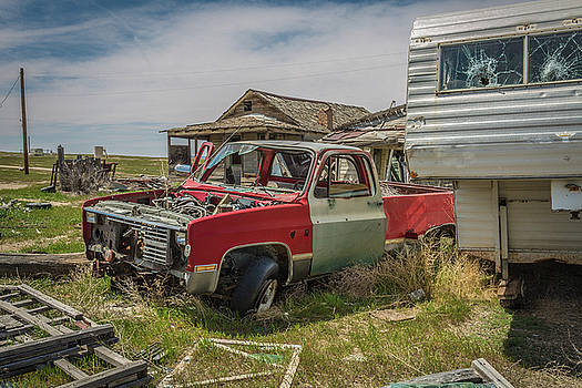 Abandoned car and trailer in the ghost town of Cisco, Utah by Janice Bennett