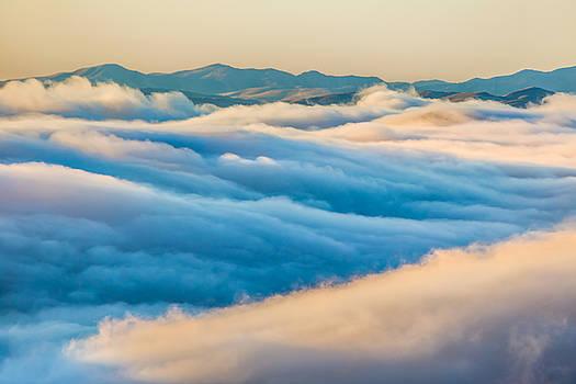 Marc Crumpler - above clouds at sunrise