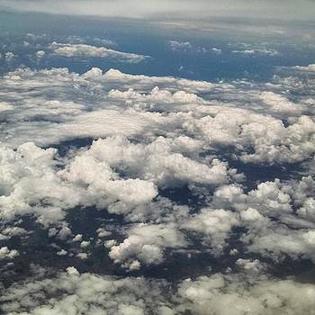 Above The Clouds From Our Flight To San by Melissa Yosua-Davis