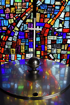 Abstract colors in a stained glass window mosaic reflected in a  by Reimar Gaertner