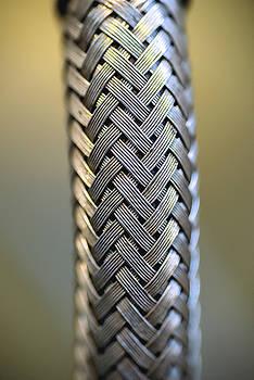 Eduardo Huelin - abstract metal water hose high detail closeup