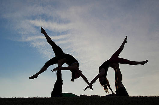 Acrobats on the Levee by Pam Kaster