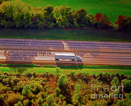 Aerial of truck on interstate transportation freight  by Tom Jelen