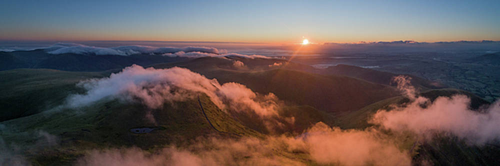 Aerial Panorama of sunrise over Scales tarn and Sharp Edge on Blencathra by Russell Millner