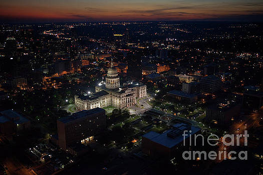 Herronstock Prints - Aerial View from a helicopter of the Texas State Capitol, Government building lit up at night in Austin, Travis County, Texas, USA