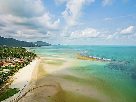 Aerial view of emerald tropical sea and beach by Lukasz Szczepanski