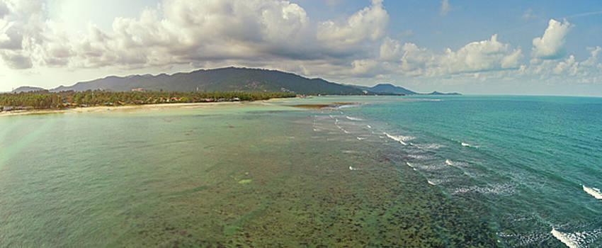 Aerial view of idyllic emerald tropical sea and beach by Lukasz Szczepanski