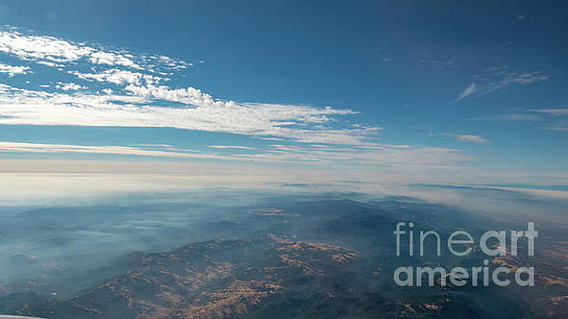 Aerial View of Mountain Formation with Low Clouds During daytime by PorqueNo Studios