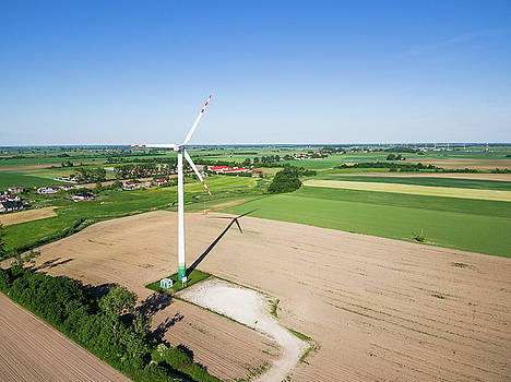 Aerial view of windmill at the countryside by Lukasz Szczepanski