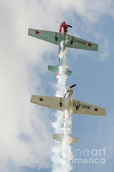 Aerostars Yak 50 Aerobatic Planes  by Simon Pocklington