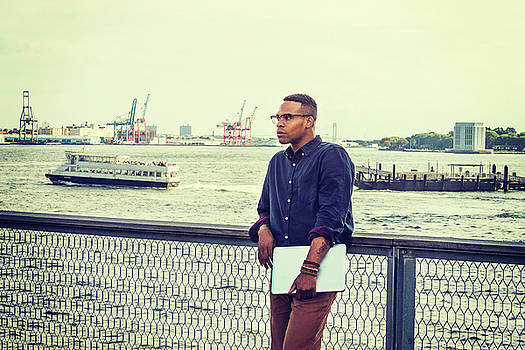 Alexander Image - African American businessman traveling on East River in New York 15082332