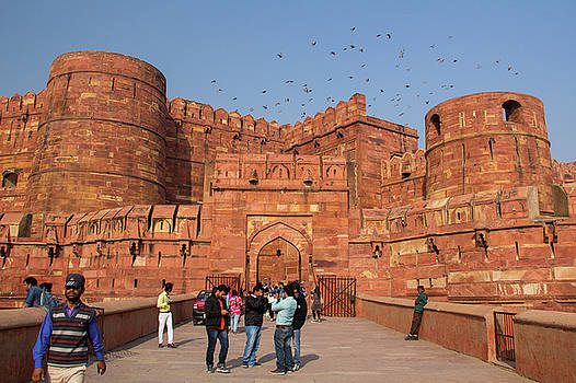 Agra Fort entrance with visitors and pigeons, India by Beth Partin
