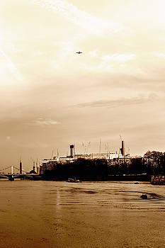 Jacek Wojnarowski - Airplane above Battersea Power Station in London sepia