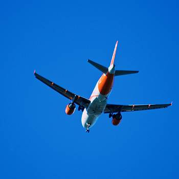 Airplane Blue Sky by Eric Tressler