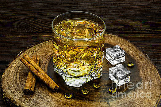 Alcoholic beverage with cinnamon and ice by Nika Lerman
