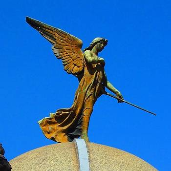 Amazing Angel Against The Bluest Sky In by Dante Harker
