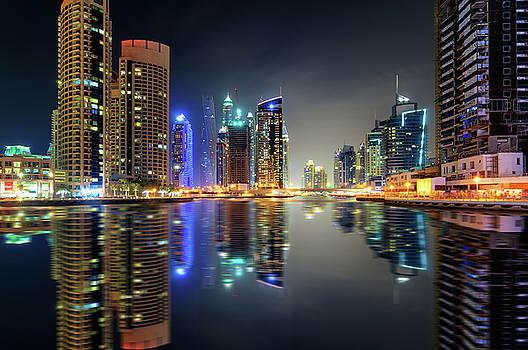 Amazing night dubai marina skyline with skyscrapers and beautiful water reflection, Dubai, United Arab Emirates by Marek Kijevsky