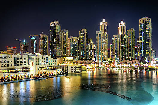 Amazing tallest skyscrapers in Sheikh Zayed road and Downtown area during night. Dubai, United Arab Emirates. by Marek Kijevsky