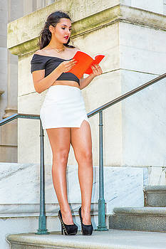 Alexander Image - Amercan female college student reading book, studying on campus
