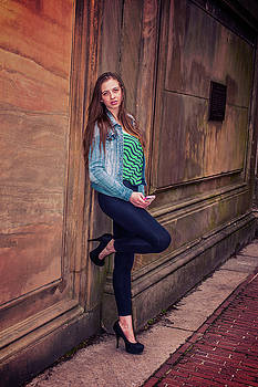 Alexander Image - American Teenage Girl holding cell phone, waiting for you outsid
