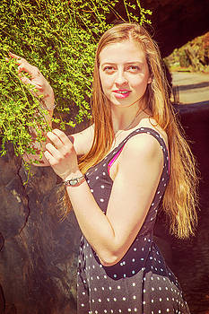 Alexander Image - American Teenage Girl Loving Green in Spring Day in New York