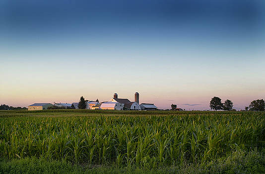 Amish farm at sunset by Earl Carter