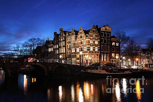 Amsterdam canal houses illuminated at dusk by IPics Photography