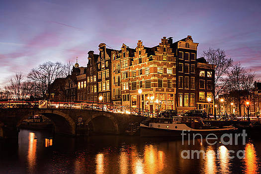 Amsterdam canal houses with reflection at dusk by IPics Photography