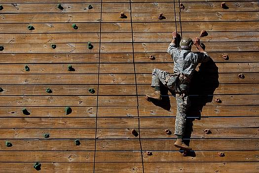 An army Ranger performs a wall climb during the best ranger competition by Paul Fearn